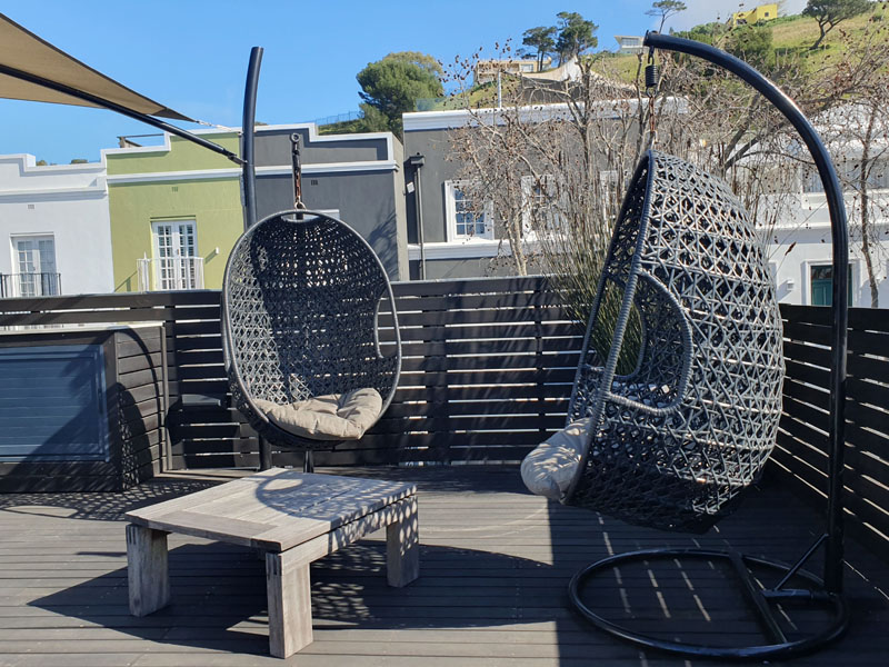 10 Loader Street - roof deck hanging chairs